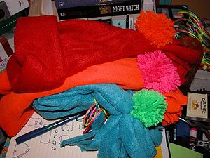 Polar fleece, with day-glo pom-pom, warm and big.