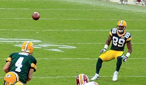 English: James Jones receives a pass from Bret...