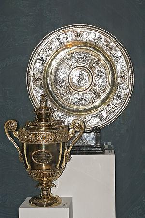Wimbledon Women's (top) and Men's singles trophies