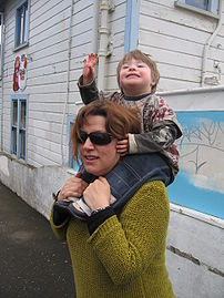 A child riding piggy-back.
