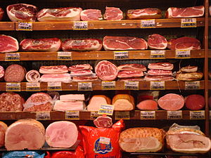 Meat counter: Prosciutto (top two rows), salam...