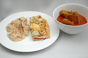 Plain roti prata (left) and egg prata (centre)...