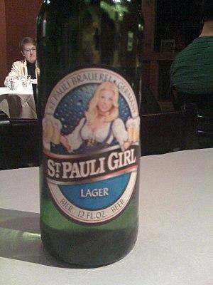 English: St. Pauli Girl (wearing a Dirndl), as...