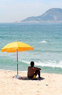 https://i0.wp.com/upload.wikimedia.org/wikipedia/commons/thumb/3/31/Man_sitting_under_beach_umbrella.JPG/200px-Man_sitting_under_beach_umbrella.JPG?w=960&ssl=1