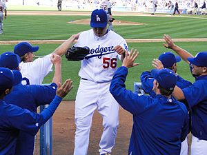 English: Hong-Chih Kuo is greeted by teammates...