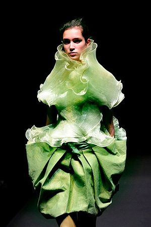 English: A model on the runway in clothes at a...