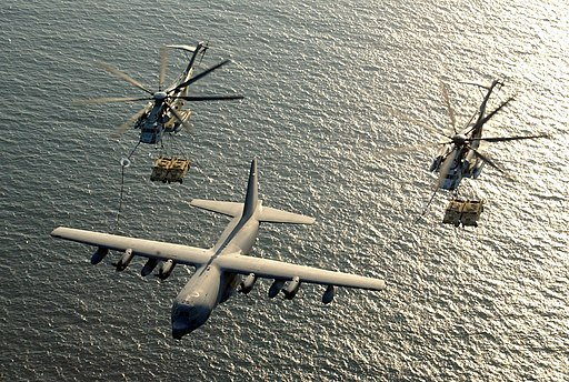 US Navy 030130-M-0000X-001 Two U.S. Marine Corps CH-53E Super Stallion helicopters assigned to Marine Heavy Helicopter Squadron-772 (HMM-772) receive fuel from a KC-130 Hercules