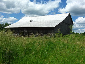 A small barn on a low hill (picture taken from...