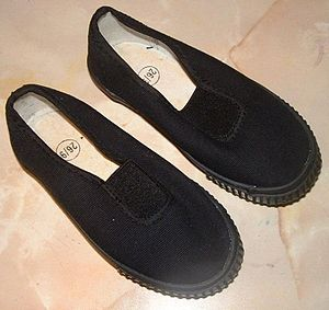 English: Traditional child's plimsolls for sch...