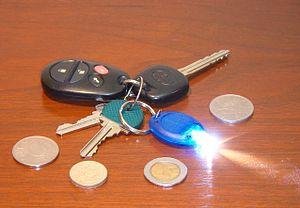 English: A key chain with a miniature LED flas...