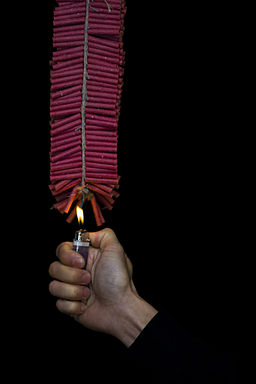 Firecrackers lit by hand