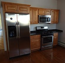 220px Newly renovated kitchen with cabinets refrigerator stove and hardwood floor Kitchen Small Space Solutions