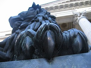 Detail of one of the two bronze lions outside ...