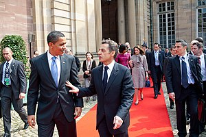 President Barack Obama walks with French Presi...