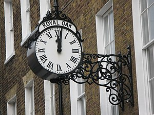 English: Clock on an office in John Street, WC...