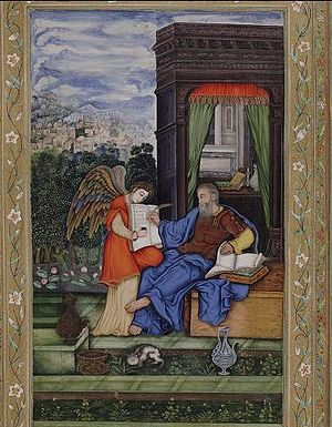 English: St. Matthew writing the Gospel with a...
