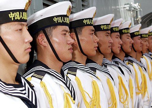 US Navy 060906-N-0879R-007 Sailors aboard the Chinese Navy destroyer Qingdao (DDG 113) stand at attention as visitors board the ship for a tour