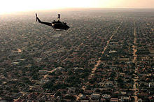 U.S. Marine Corps helicopter surveying a residential area inMogadishu as part of Operation Restore Hope (1992).