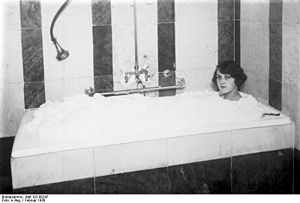 A woman in a bubble bath (Berlin, February 1930).