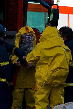 English: Firefighters getting suited in HAZMAT...