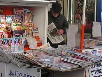 Newspaper vendor, Paddington, London, February...