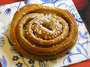 Swedish cinnamon bun with crushed nib sugar