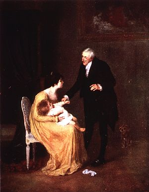 A young mother consults with a doctor over the...