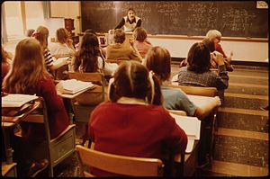 STUDENTS AND TEACHER IN A CLASSROOM AT CATHEDR...