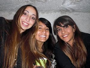 English: Three young women