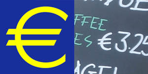 English: The Euro symbol (€) printed and in ha...