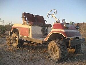 English: Off road gas golf cart.