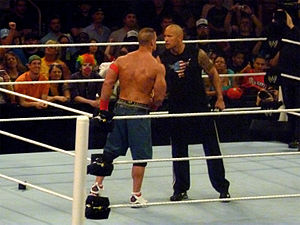 English: The Rock and John Cena agree to a mat...
