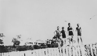 File:StateLibQld 2 165651 Young boys standing on the wall