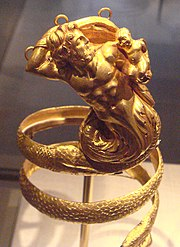 Gold armband with Triton holding a putto, Greek, 200 BCE (Metropolitan Museum of Art)