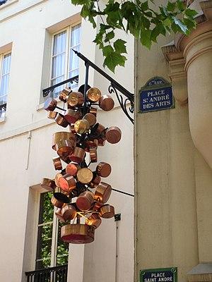 Copper pots hung on the Place St André des Art...
