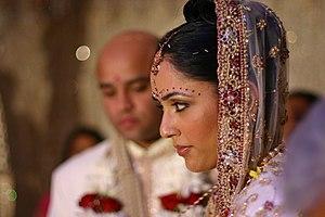 English: A Hindu bride during traditional wedd...