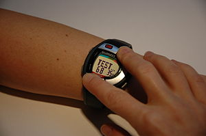 English: Picture of person taking Heart Rate o...