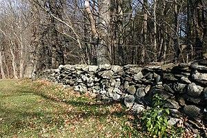 Description: Photograph of a rock fence taken ...