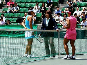 An umpire informing Kimiko Date and another Ja...