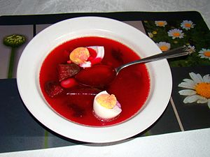 English: Beetroot soup with vegetables and har...