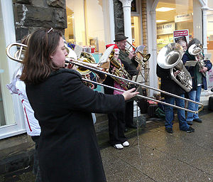 English: Brass band playing Christmas carols S...