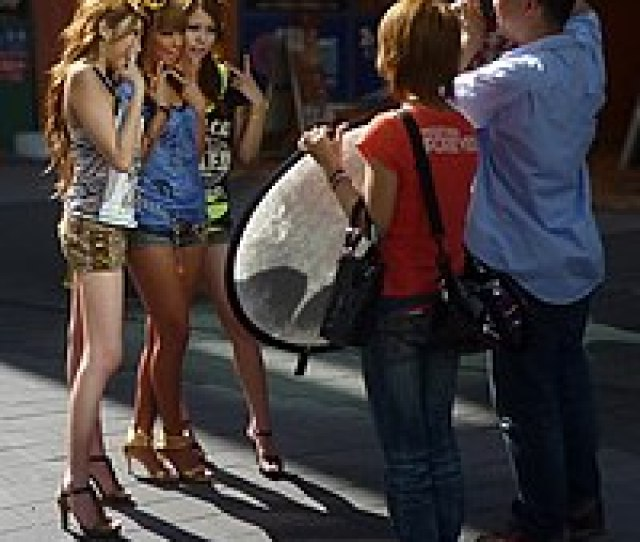 Three Unknown  E  Ae E  A E  Ab Gal Models Being Photographed