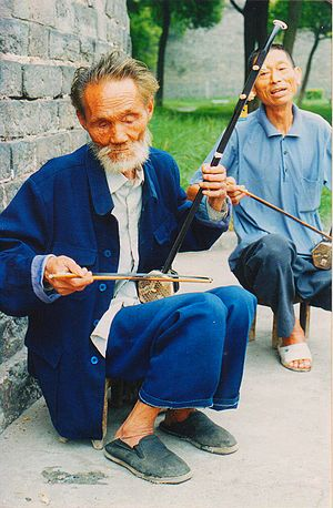 English: Erhu being played by a blind man in H...