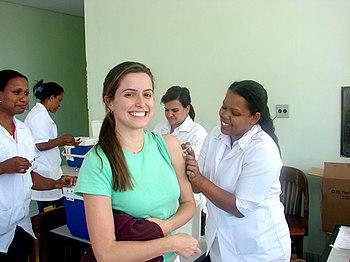 English: Woman receiving rubella vaccination, ...