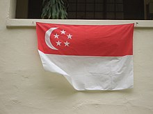 A home displaying the national flag underneath their window