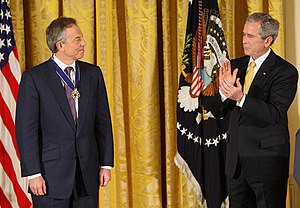 President George W. Bush applauds former Prime...
