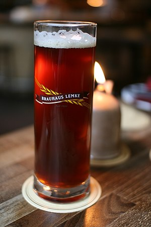 English: Dark Brauhaus Lemke beer in glass. Ру...