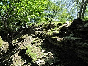 English: The ruined walls A view along the rui...