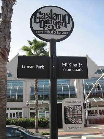 A directional sign near the Gaslamp Quarter of...
