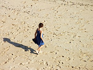 Girl walking in a beach. Porto Covo, Portugal.